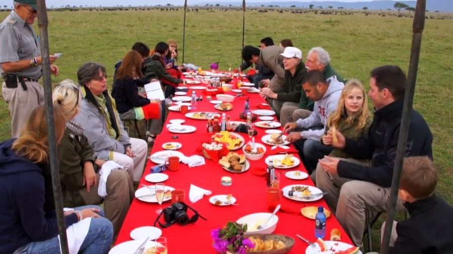 eating traditional native african food on private african tour safari after hot air balloon