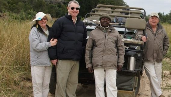 tourists with african man southern african luxury safari trip